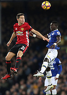 Ander Herrera of Manchester United and Tramiro Funes Mori of Everton during the Premier League match at Goodison Park, Liverpool. Picture date: December 4th, 2016.Photo credit should read: Lynne Cameron/Sportimage