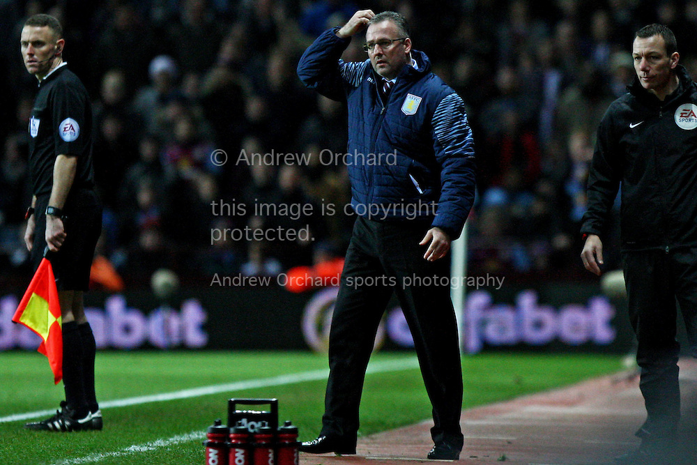 Aston Villa manager Paul Lambert scratches his head in disbelief after his player Gabby Agbonlahor receives a red card. Barclays Premier league match, Aston Villa v Manchester Utd at Villa Park in Birmingham on Saturday 20th December 2014<br /> pic by Mark Hawkins, Andrew Orchard sports photography.