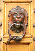 Antique brass foot knocker of lion holding a snake in its mouth, Newbury museum, Berkshire, England, UK