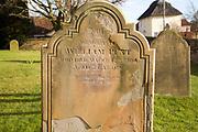 Headstones of graves in churchyard of Saint Peter church, village of Levington, Suffolk, England, UK