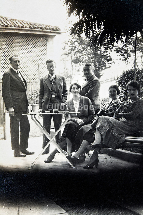 people relaxing outdoors with a cup of tea 1930s
