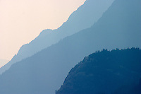 Mountain ridges form shadows above Upper Campbell Lake, Vancouver Island BC