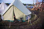 A small child peaks out of her Bell Tent with a trench around at the Glastonbury Festival 20th July 2016, Somerset, United Kingdom.  The Glastonbury Festival runs over 3 days and has 3000 acts, including music, art and performance and approx. 150.000 attend the anual event.