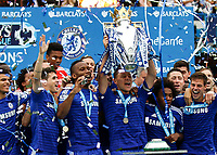 Football - 2014 / 2015 Premier League - Chelsea vs. Sunderland.   <br /> <br /> Chelsea's John Terry collects the Barclay's Premier League Trophy at Stamford Bridge. <br /> <br /> COLORSPORT/DANIEL BEARHAM