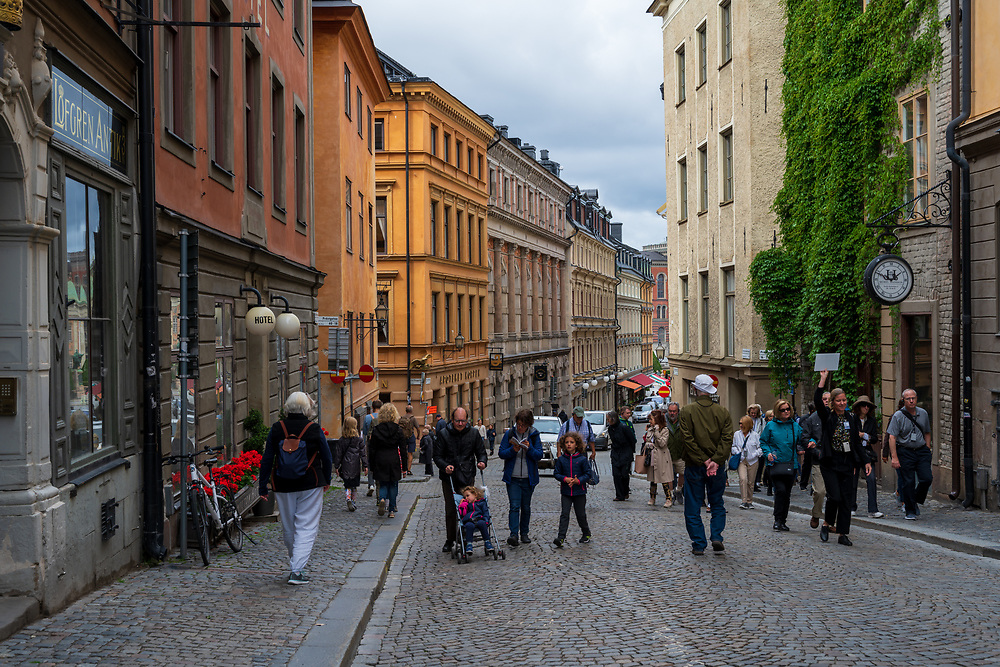 Stockholm, Sweden -- July 16, 2019. A Street in Old Town is crowded with pedestrians, tourists and shoppers.