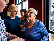 17 APRIL 2019 - DES MOINES, IOWA: A Des Moines resident greets US Senator KIRSTEN GILLIBRAND (D-NY), right, before a meet and greet with Drake University students at a restaurant in Des Moines. Gillibrand is touring Iowa this week to support her candidacy to be the Democratic nominee for the US Presidency. Iowa traditionally hosts the the first selection event of the presidential election cycle. The Iowa Caucuses will be on Feb. 3, 2020.              PHOTO BY JACK KURTZ