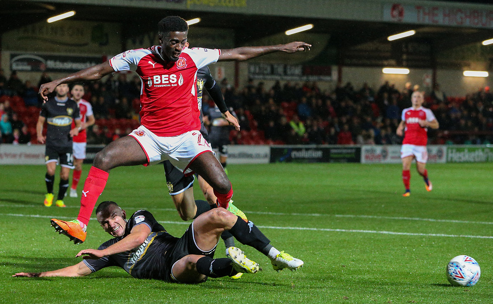 Fleetwood Town's Jordy Hiwula is tackled by Bury's Tom Aldred<br /> <br /> Photographer Alex Dodd/CameraSport<br /> <br /> The EFL Sky Bet League One - Fleetwood Town v Bury - Tuesday 12th September 2017 - Highbury Stadium - Fleetwood<br /> <br /> World Copyright © 2017 CameraSport. All rights reserved. 43 Linden Ave. Countesthorpe. Leicester. England. LE8 5PG - Tel: +44 (0) 116 277 4147 - admin@camerasport.com - www.camerasport.com