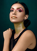 Editorial Fashion Photography using Profoto B1 lights. Black reflectors were used on the side of the portrait. Profoto Barn doors were used to control the light fall. Shot with Phaseone IQ 250. Golden shine was done by the makeup artist with a pink eye shadow for the contrast.