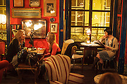 The bar room at Pensão Amor, a former pension that is now a bar with art performances, erotic bookshop and rooms for renting to artistic entrepreneurs.