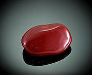 Cutout of a Red Jasper gemstone on black background