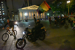 June 28, 2017 - Buenos Aires, Argentina - Man rides motorcycle during a protest against travesticide (crimes against transgender people) in Buenos Aires, Argentina. (Credit Image: © Anton Velikzhanin via ZUMA Wire)