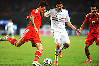 Zhang Linpeng of China, left, challenges Christian Ovelar of Paraguay during a friendly football match in Changsha city, central China's Hunan province, 14 October 2014.<br /> <br /> Paraguay's dismal run of form continued as they suffered a 2-1 friendly defeat to China on Tuesday (14 October 2014). The South American nation, who came into the game having won two of their previous 13 fixtures, fell short in their bid to pull off a late comeback at Changsha's Helong Stadium. In contrast to their opponents, China have now lost just two of their last 16 matches as they continue to build towards next year's AFC Asian Cup in Australia.