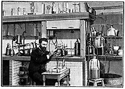 Henri Moissan (1852-1907) French chemist, working on Fluorine in his laboratory at l'Ecole de pharmacie, Paris. He isolated Fluorine in 1883. Later in his career he worked on the production of artificial gems, particularly diamonds.  From 'La Nature', Paris, 1903