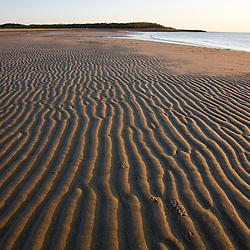 Patterns in the sand on the beach  at the Shifting Lots Preserve in Plymouth, Massachusetts.  Owned by the Wildlands Trust.  Cape Cod Bay.  Near Ellisville Harbor State Park.