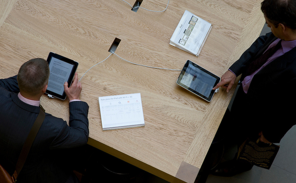 Two men are testing the iPad, at the Apple store in Covent Garden, London. The release of the iPad II takes place on Friday at 5 pm, and will replace the earlier version.  (AP Photo/Bogdan Maran)
