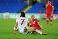 Craig Bellamy of Wales is tackled by Simon Vukcevic. Euro 2012 Qualifying match, Wales v Montenegro at the Cardiff City Stadium in Cardiff  on Friday 2nd Sept 2011. Pic By  Andrew Orchard, Andrew Orchard sports photography,