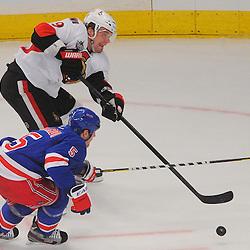 Ottawa Senators left wing Milan Michalek (9) slips a pass past New York Rangers defenseman Dan Girardi (5) during first period NHL action between the Ottawa Senators and the New York Rangers at Madison Square Garden.