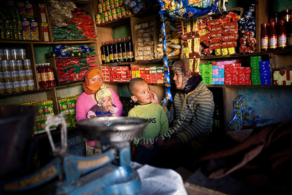 Local shop-owners sitting in their shop catered for travellers and excursionists along the Leh-Manali Highway.