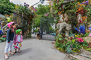 A young family and their dog inspect the final preparations for the Safary in Bloom gates at the Chelsea Flower Show organised by the Royal Horticultural Society with M&G as its amin sponsor for teh final year.