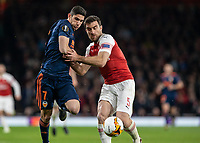 Football - 2018 / 2019 UEFA Europa League - Semi-Final, First Leg: Arsenal vs. Valencia CF<br /> <br /> Goncalo Guedes (Valencia) and Sokratis Papastathopoulos (Arsenal FC) battle for the loose ball  at The Emirates.<br /> <br /> COLORSPORT/DANIEL BEARHAM