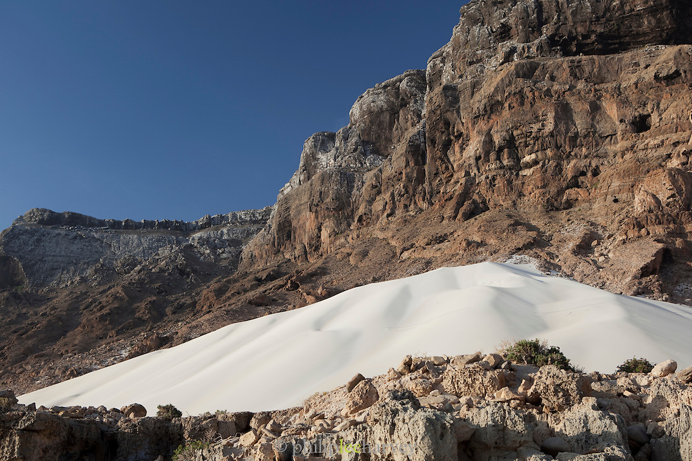 A huge sand dune at the bottom of the cliffs at Arhur, Socotra, Yemen