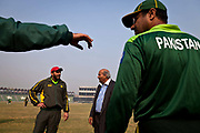 Pakistan National Cricket team captain Shahid Afridi in discussion with manager Intikhab Alam inside Gaddafi Stadium,   during a week long training camp period prior to the 2011 ICC World Cricket cup in Sri Lanka, India and Bangladesh