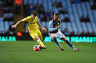 Sheffield Utd's  Ryan Flynn(left) battles with Aston Villa's Antonio Luna  during the FA Cup with Budweiser, 3rd round, Aston Villa v Sheffield Utd match  at Villa Park in Birmingham, England on Saturday 4th Jan 2014.<br /> pic by Jeff Thomas, Andrew Orchard sports photography.