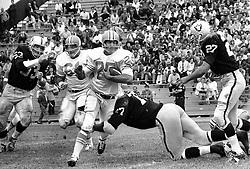 Oakland Raiders vs. Houston Oilers (at Frank Youell Field in Oakland)..Raiders Dan Birdwell and #27 Joe Krakoski.                             (photo by Ron Riesterer)