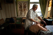 Marc Piscotty/News Staff Photographer<br />SHOT 11/12/2002 - Tanzila Abdrakhimova, 51, of Tatar Karabolka gets a massage from Dr. Igor Okishev at the Urals Center for Radiation Medicine in Chelyabinsk one afternoon. Patients receive massages for increased blood flow and circulation. Many of the villages near Mayak sat directly in the path of the fallout of the 1957 accident at the Mayak nuclear facility located a few miles away. Patients at the center are all from contaminated areas near Mayak and most believe their health problems are a result of chronic radiation sickness. The center can only hope to treat the pain because there is nothing that can done for radiation contamination.