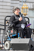 San Francisco, USA. 19th January, 2019. The Women's March San Francisco begins with a rally at Civic Center Plaza in front of City Hall. Alicia Contreras, Executive Director of the East Bay Spanish Speaking Citizen's Foundation, addresses the crowd. Contreras is a recipient of the Paul Hearne Award and negotiated the first city funding in San Luis Potosi for disabled people.  Credit: Shelly Rivoli/Alamy Live News