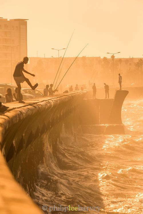 Sea waves splashing against corniche on bright sunny day, Casablanca, Morocco