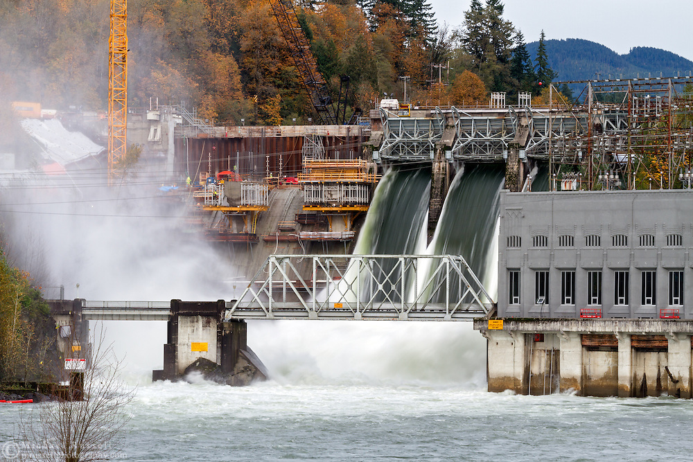 The Ruskin Dam in Mission, British Columbia, Canada with three of its spillways wide open to accommodate runoff from recent rain storms. The dam is undergoing a refit to upgrade the facilities that were originally constructed in the 1930's.