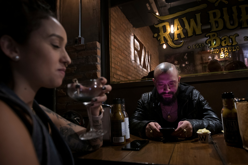 São Paulo, Brazil - April 13, 2019: Victor Montaghini, a well known tattoo artist, at the Raw Burger Bar in Sao Paulo, Brazil.