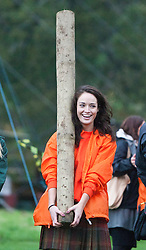 Miss Scotland Jennifer Reochs tosses the caber..The Miss World 2011 contestants take part in Highland Games in the grounds of Crieff Hydro, Perthshire..MISS WORLD 2011 VISITS SCOTLAND..Pic © Michael Schofield.
