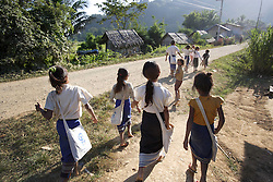 Soutchay receives a Plan International scholarship and (no age given) walks home from school with a group of friends, she lives just minutes from the primary school in Phangthong Village, Pha Oudom District, Bokeo Province, Lao PDR