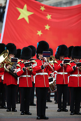 © Licensed to London News Pictures. 20/10/2015. London, UK. The band of the Irish Guards plays in The Mall in front of a giant Chinese flag as a four day State Visit to the United Kingdom by Chinese President Xi Jinping gets under way. Photo credit: Peter Macdiarmid/LNP