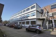 Nederland, Nijmegen, 23-11-2020 Bron en contactonderzoek bij de GGD . telefonisch worden positief geteste mensen benaderd voorhet doorgeven van hun contacten de afgelopen tijd. Het gebouw is drie containers hoog en ligt naast het hoofdgebouw en de teststraat.Foto: ANP/ Hollandse Hoogte/ Flip Franssen