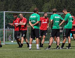 16.07.2013, Trainingsplatz, Walchsee, AUT, 1. FBL, Augsburg Trainingslager, im Bild Das Trainerteam ( v.li. Markus WEINZIERL, Wolfgang BELLER und Tobias ZELLNER) beobachten die Spieler Halil ALTINTOP (li), Andre HAHN und Sascha M√ñLDERS, MOELDERS, // during a Training Session of German Bundesliga Club Augsburg at the Training Ground, Walchsee, Austria on 2013/07/17. EXPA Pictures © 2013, PhotoCredit: EXPA/ Eibner/ Klaus Rainer Krieger<br /> <br /> ***** ATTENTION - OUT OF GER *****