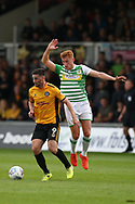 Padraig Amond of Newport county (l)  breaks away from Matt Worthington of Yeovil Town ® .EFL Skybet football league two match, Newport county v Yeovil Town at Rodney Parade in Newport, South Wales on Saturday 7th October 2017.<br /> pic by Andrew Orchard,  Andrew Orchard sports photography.