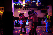 Couples are dancing Quizomba in a nightclub on the island of Sao Tome, Sao Tome and Principe, (STP) a former Portuguese colony in the Gulf of Guinea, West Africa.