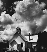 A storm cloud drifted over the Community Methodist Church in Conconully, Okanogan County. (Josef Scaylea / The Seattle Times, 1976)
