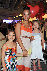 ANGELA GRIFFIN and her daughters TALLULAH and MISSY at a tea party to celebrate the launch of the limited edition Heart & Sole shoe collection by Step2wo in aid of the British Heart Foundation's Mending Broken Hearts Appeal, held at Aubaine on 2, Selfridge's, Oxford Street, London on 4th July 2012.