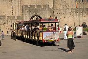 female friend making a snapshot of their tourist attraction La Cite Carcassonne France