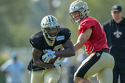 July 28, 2018 - Metairie, LA, U.S. - METAIRIE, LA. - JULY 28:   New Orleans Saints quarterback Taysom Hill (7) hands the ball off to running back Terrance West (38) during New Orleans Saints training camp practice on July 28, 2018 at the Ochsner Sports Performance Center in New Orleans, LA.  (Photo by Stephen Lew/Icon Sportswire) (Credit Image: © Stephen Lew/Icon SMI via ZUMA Press)
