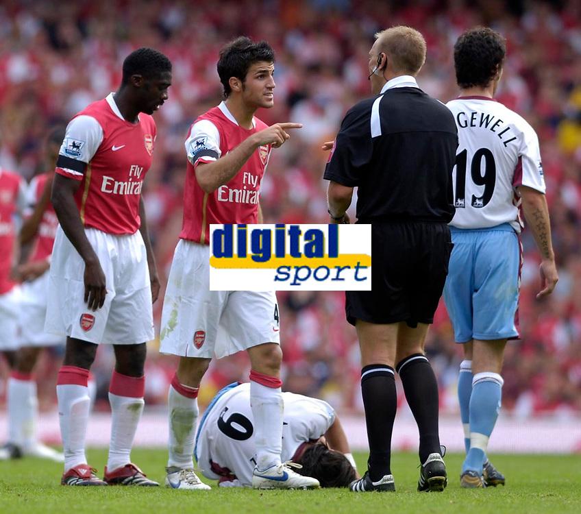 Photo: Daniel Hambury.<br />Arsenal v Aston Villa. The Barclays Premiership. 19/08/2006.<br />Arsenal's Francesc Fabregas (2nd left) shouts at referee Graham Poll after a tackle on Villa's Juan Pablo Angel (on floor) by Kolo Toure (L).