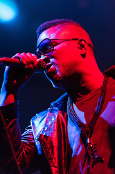 """© Licensed to London News Pictures. 01/05/2015. London, UK.   Shabazz Palaces performing live at Brixton Academy, supporting headliner Flying Lotus.  Shabazz Palaces are an American, Seattle-based experimental hip-hop group led by Ishmael Butler, aka Palaceer Lazaro (formerly Butterfly of jazz–hip hop group Digable Planets) and multi-instrumentalist Tendai """"Baba"""" Maraire Photo credit : Richard Isaac/LNP"""