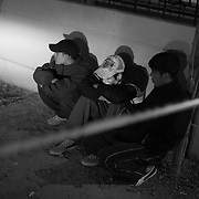 Family members of a man killed near his home by cartel affiliated gangs sit by the crime scene as police collect evidence in Ciudad Juarez, Mexico.<br /> (Credit Image: © Louie Palu/ZUMA Press)
