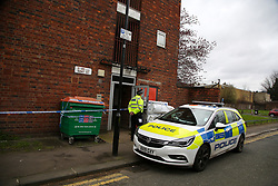 © Licensed to London News Pictures. 26/03/2021. London, UK. A police officer guards the entrance to the residential properties on Kent Street in Newham, East London following death of an elderly woman. Police were called just after 10pm on Thursday, 25 March and found the 76-year-old woman dead. A man aged in his 30s was arrested at the scene on suspicion of murder and remains in police custody. Photo credit: Dinendra Haria/LNP