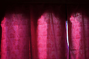 Red curtains at a window in a traditional Bhutanese farmhouse in Punakha valley, Bhutan