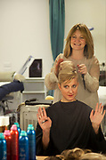 CRAWLEY, WEST SUSSEX, UK, OCTOBER 27TH 2011. Journalist / writer Andrea Sachs is primped and preened the the hair and make up department by one of the teachers / trainers during research on a story about Virgin Atlantic air stewardess and steward training at The Base training facility. (Photo by Mike Kemp for The Washington Post)